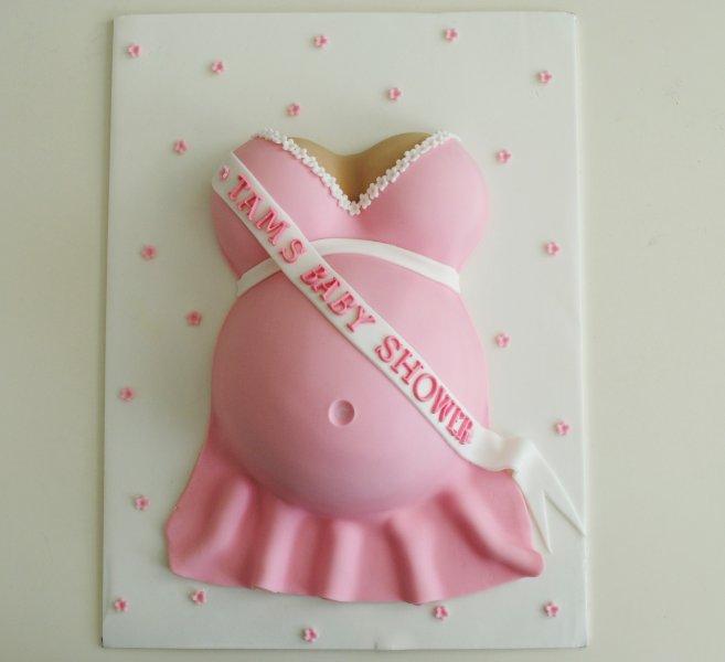 Pink girl baby shower baby bump cake