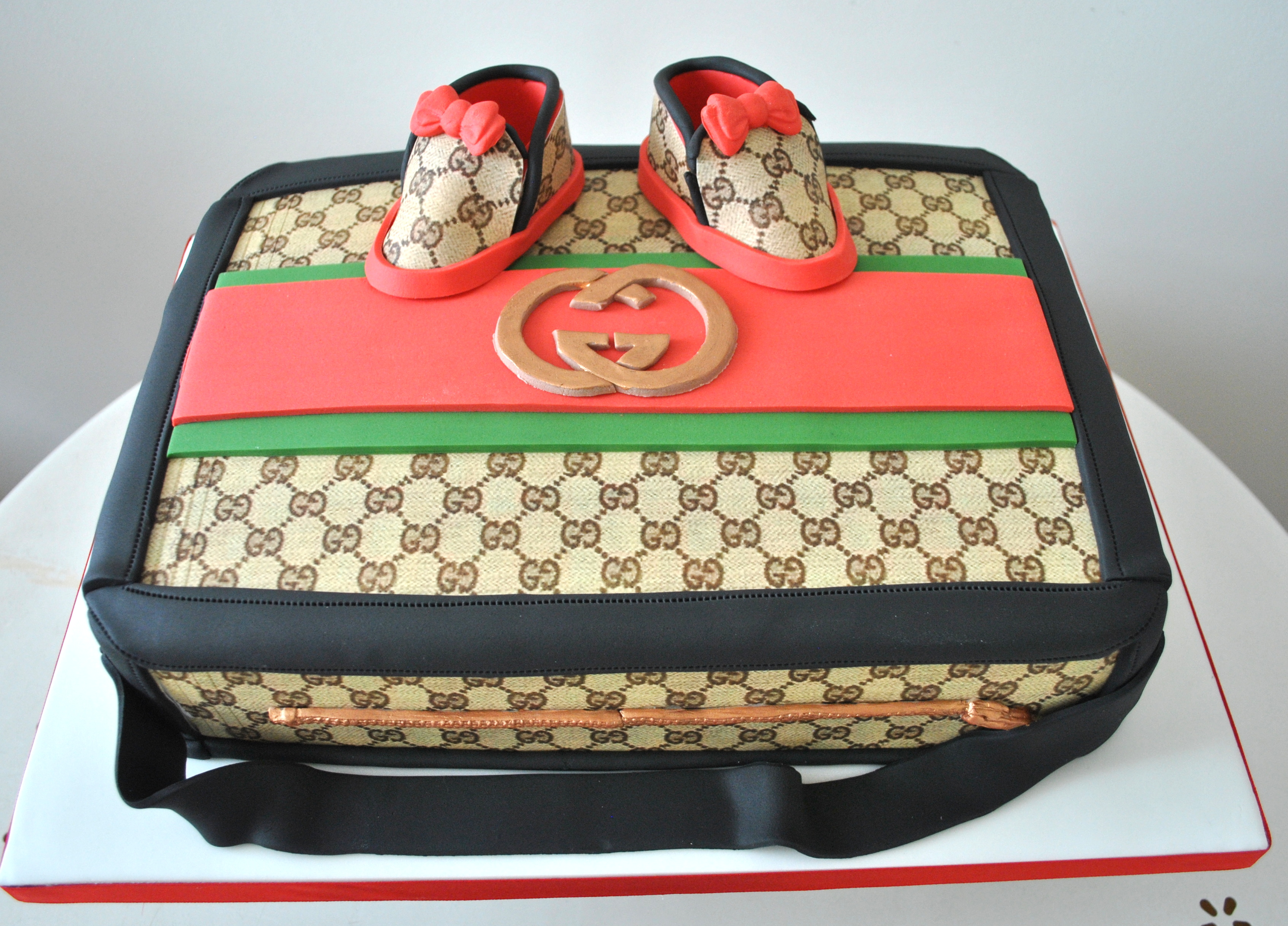 Gucci case baby shower cake