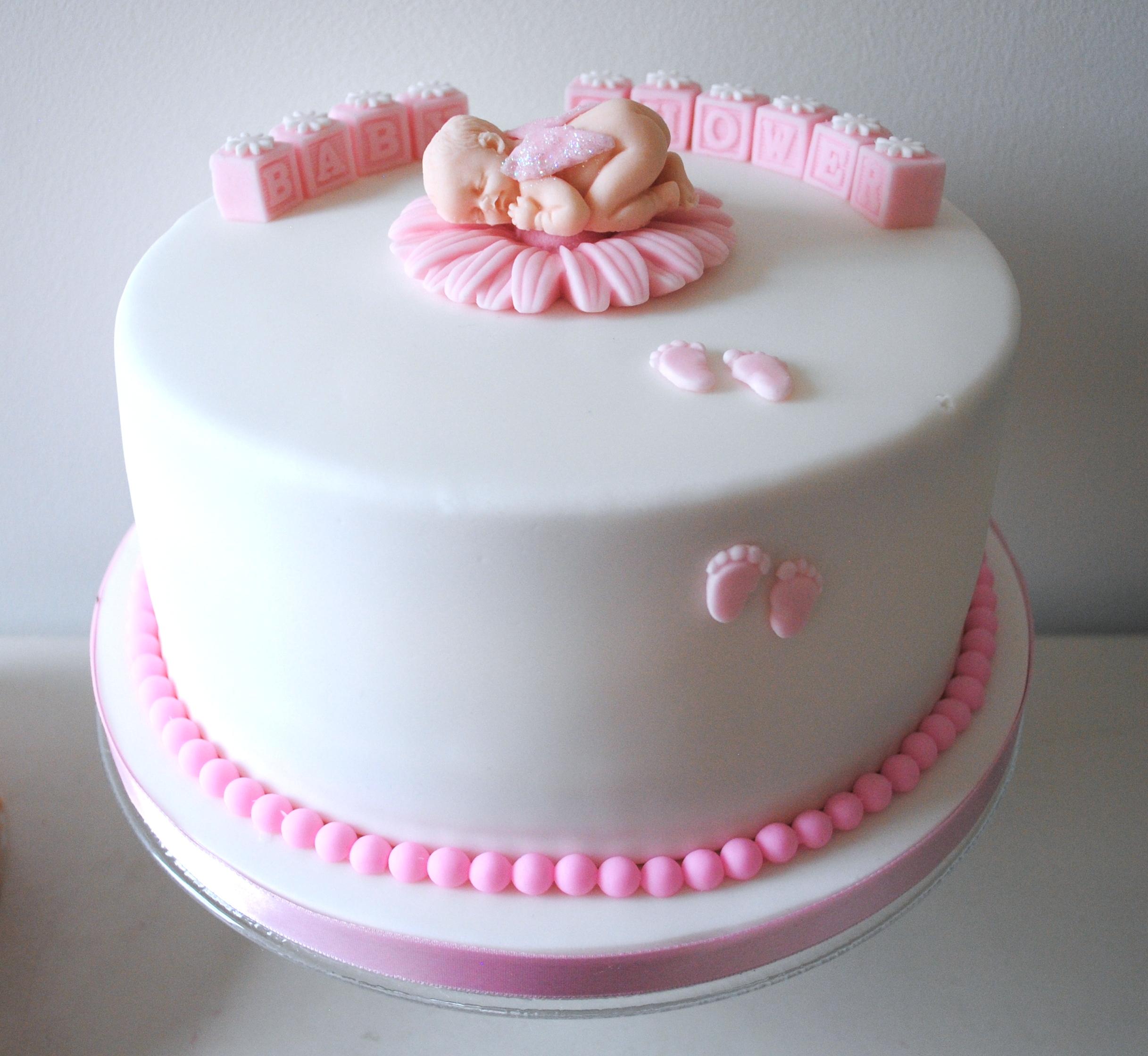 Pink girl baby shower cake