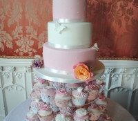 Chic pink and white 3 tier wedding cake and cupcakes