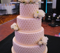 4 tier quilted ivory rose wedding cake