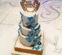 Blue and gold butterfly 4 tiered wedding cake