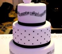 Bride and groom guitar music script wedding cake