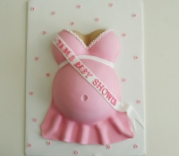 Pink girl baby shower baby bump cake