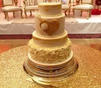 4 tiered gold heart rose swirl cake