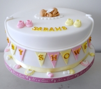 Pink and yellow baby shower cake