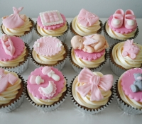 Pink girl baby shower cupcakes