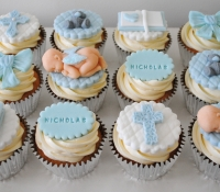Boy christening cupcakes