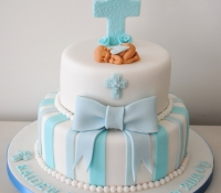 2 tier boy christening cross and bow cake