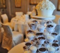 Wedding stand rose swirl cupcakes and giant cupcake cake