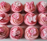 Pink butterfly and flower cupcakes