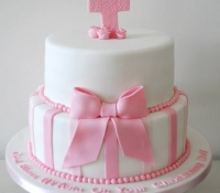 2 tiered christening cake with cross